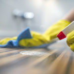 Cleaning-kitchen-table-with-blue-cloth