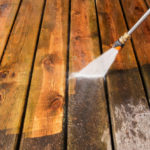 Pressure-Washer-Cleaning-a-Weathered-Deck