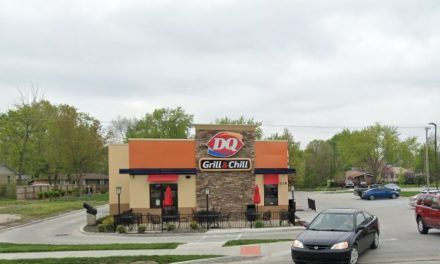Gardner Dairy Queen fumbles inspection; placed raw hamburgers on the grill and without removing gloves and washing hands proceeded to make a cheeseburger, touching the bun, cheese slice and cooked hamburger