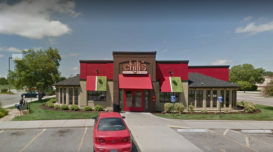 Chili's Bar and Grill fouls inspection; At bar, Martini glasses stored as clean with food debris remaining on them, 5 violations