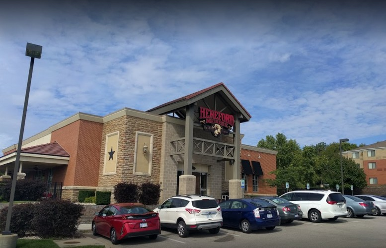 Hereford House in Shawnee bumbles inspection;  Liquor bottle with 6 small winged insects, 15 small winged insects landing on bottles, insects observed on walls, clean dishes