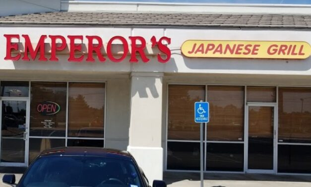 Inspection Emperor's Japanese Grill in Wichita; flies landing on food contact surfaces person cutting chicken had to keep swatting them away