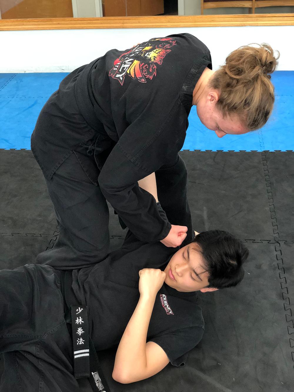 Journey Martial Arts Teen thrust punching a teen opponent