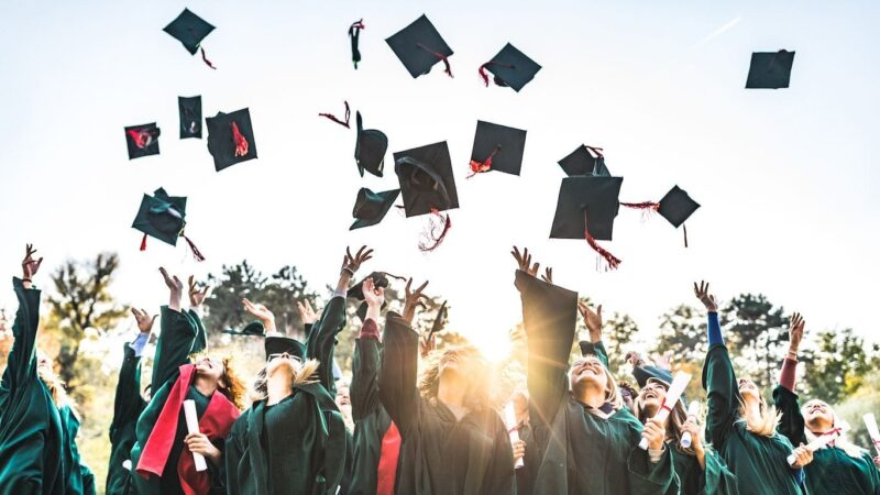 Students throwing caps in the air after graduation.