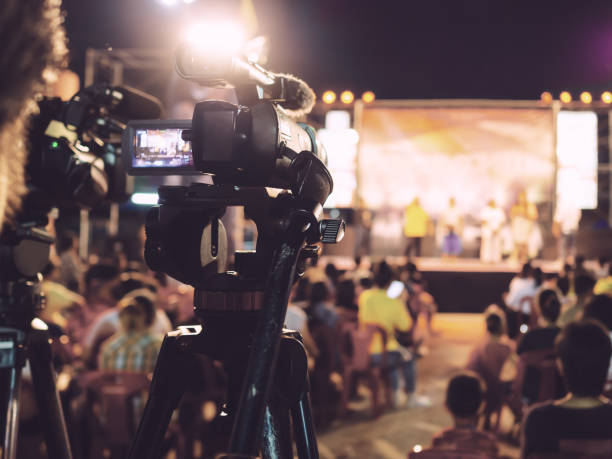 Camera behind an audience pointed at the stage.