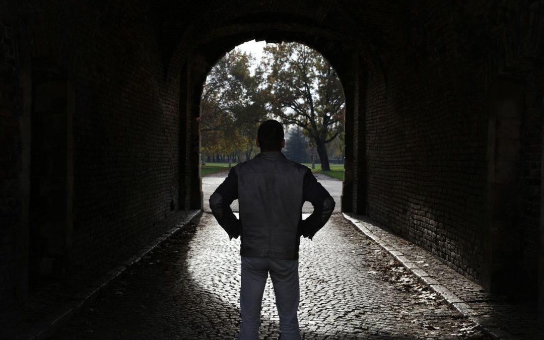 The Sinclair Method Alcohol Addiction treatment blog image man standing light at end of tunnel