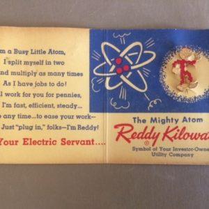 Reddy Kilowatt pin on original card