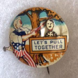 WW II Uncle Sam hanging Hitler pin