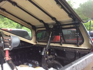 Truck topper lift and wheelchair lift