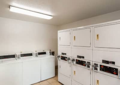 Laundry Room with rows of washers and dryers