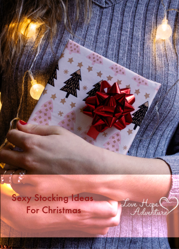 woman holding a present for sexy stocking ideas for Christmas