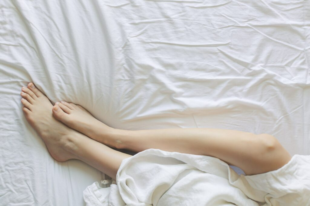 person in bed with just feet showing