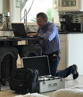Inspector Donohue Entering an Inspection Finding on His Computer