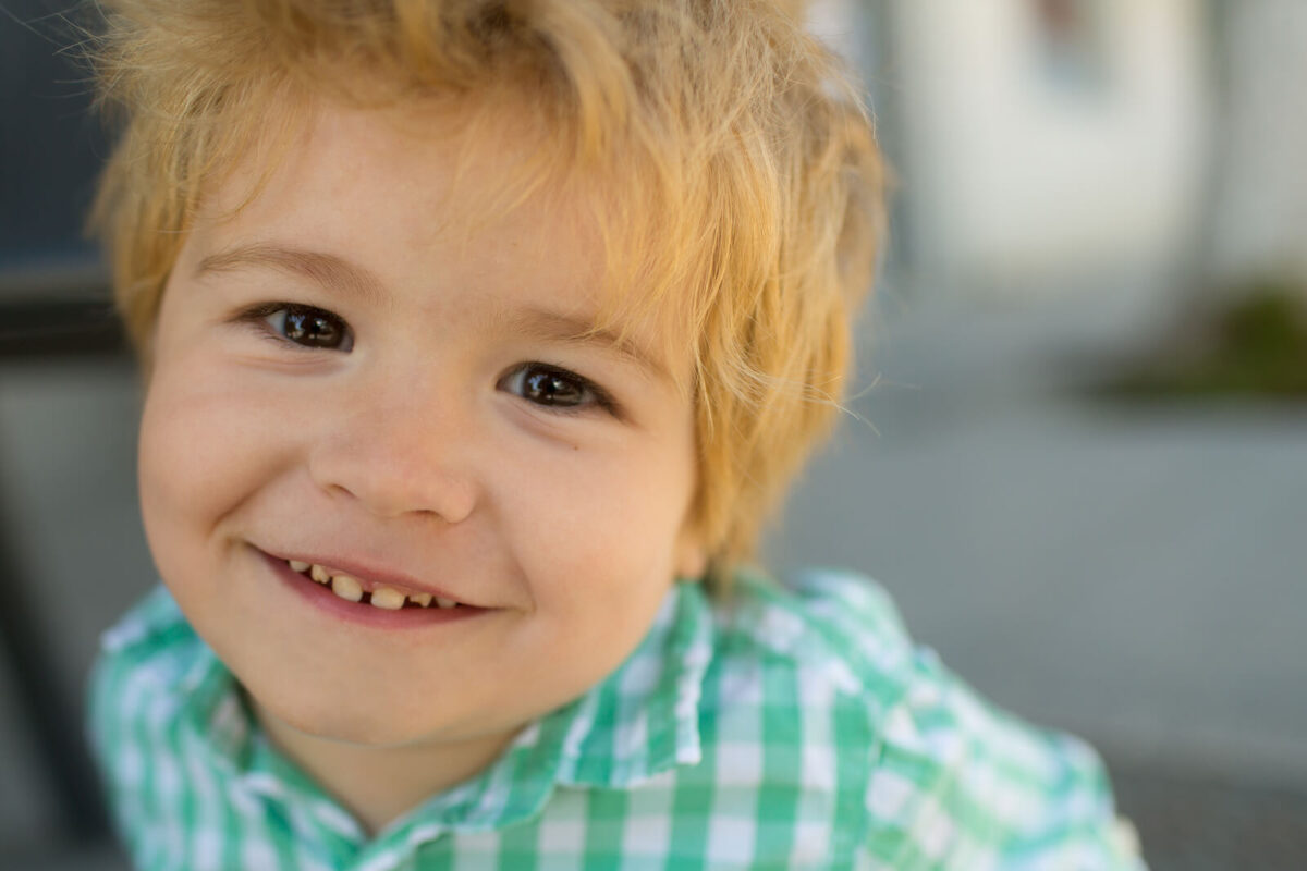 Child with baby teeth