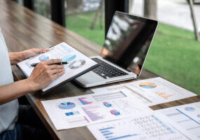 Business Woman Accountant Working Audit And Calculating Expense