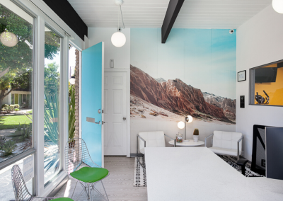 Leasing office with blue door and picture of mountains on wall