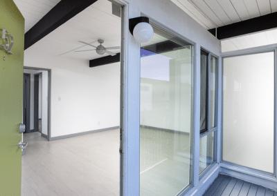 Green door open to the apartment unit