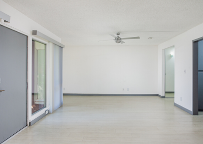 empty living room with view into other rooms