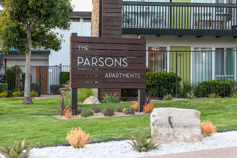 The Parsons Entrance Sign with grass