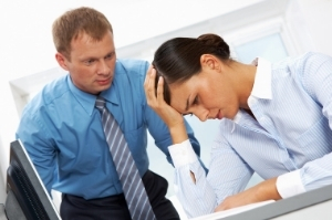 Woman having a headache as a result of bad corporate practice in San Jose