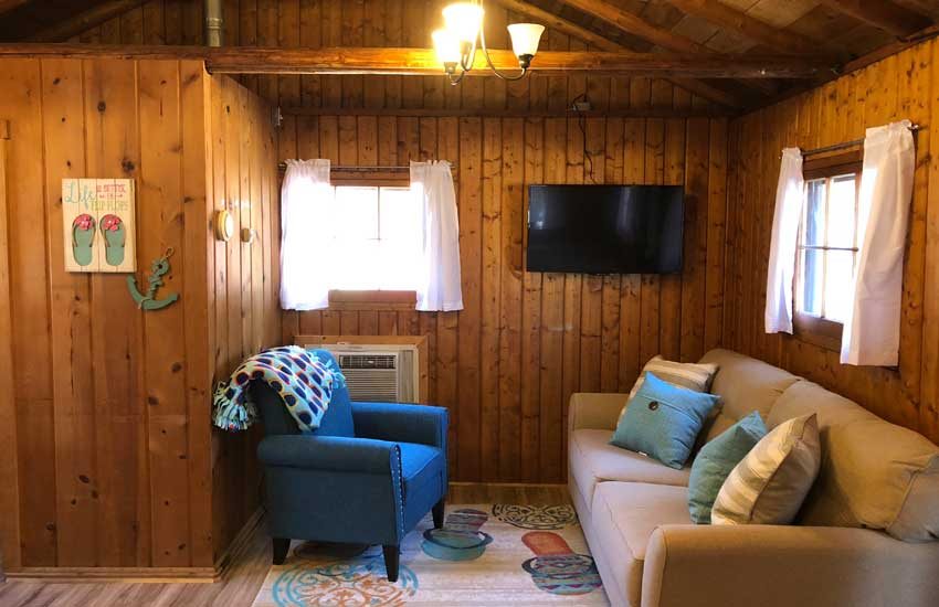 cozy cove cabins living room with couch