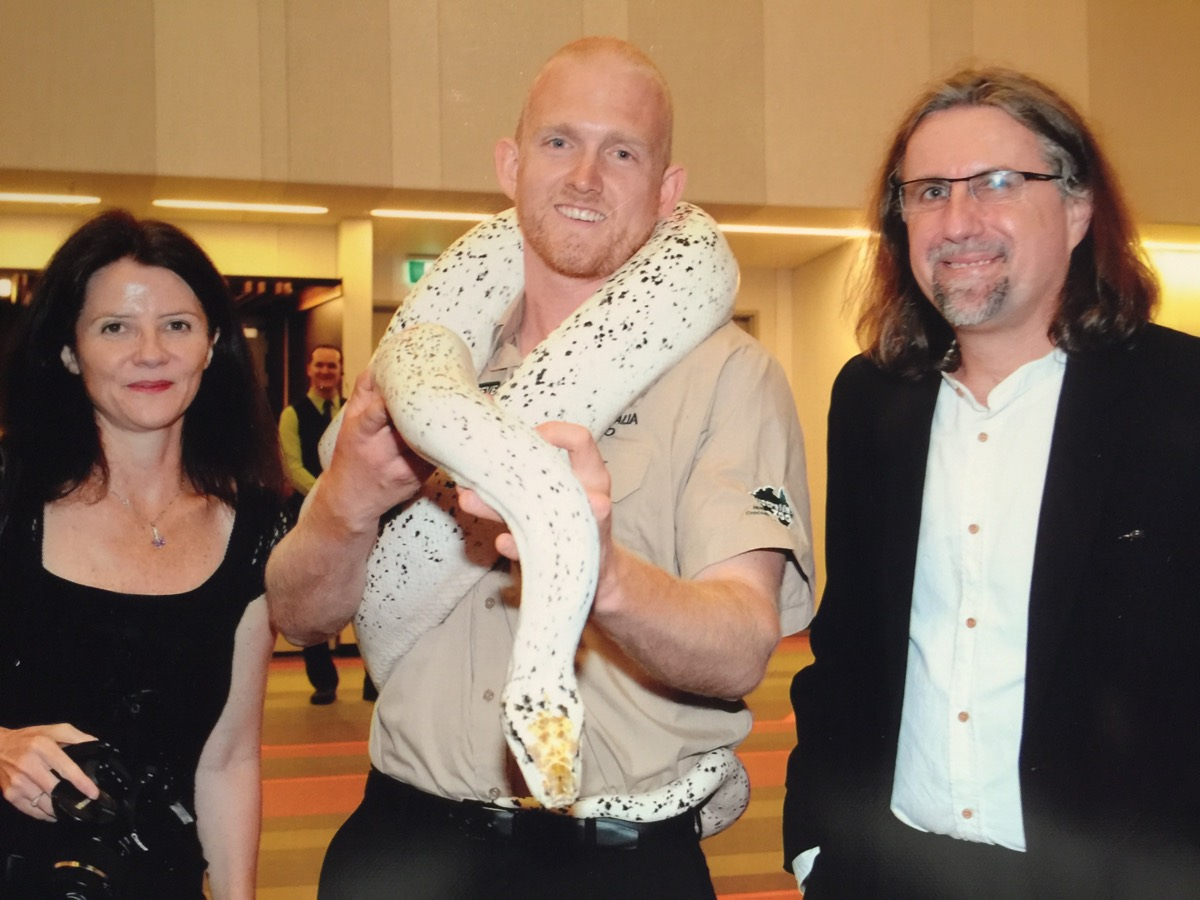 Minnik Integrated Financial Solutions - Australia Zoo - Leah Oliver and Christian Warta with Australia Zoo's favorite python