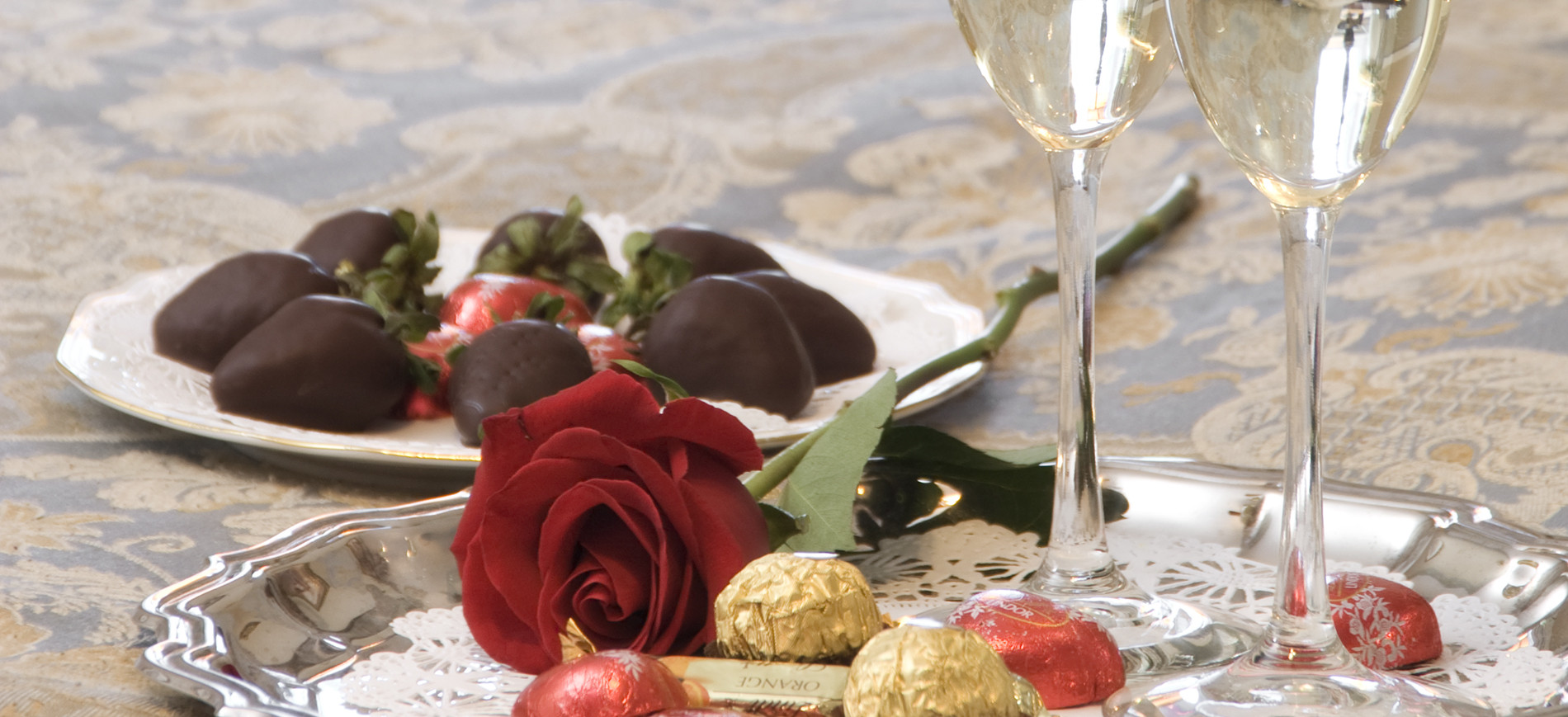 Chocolate Strawberries, rose, candy, champagne glasses on silver tray
