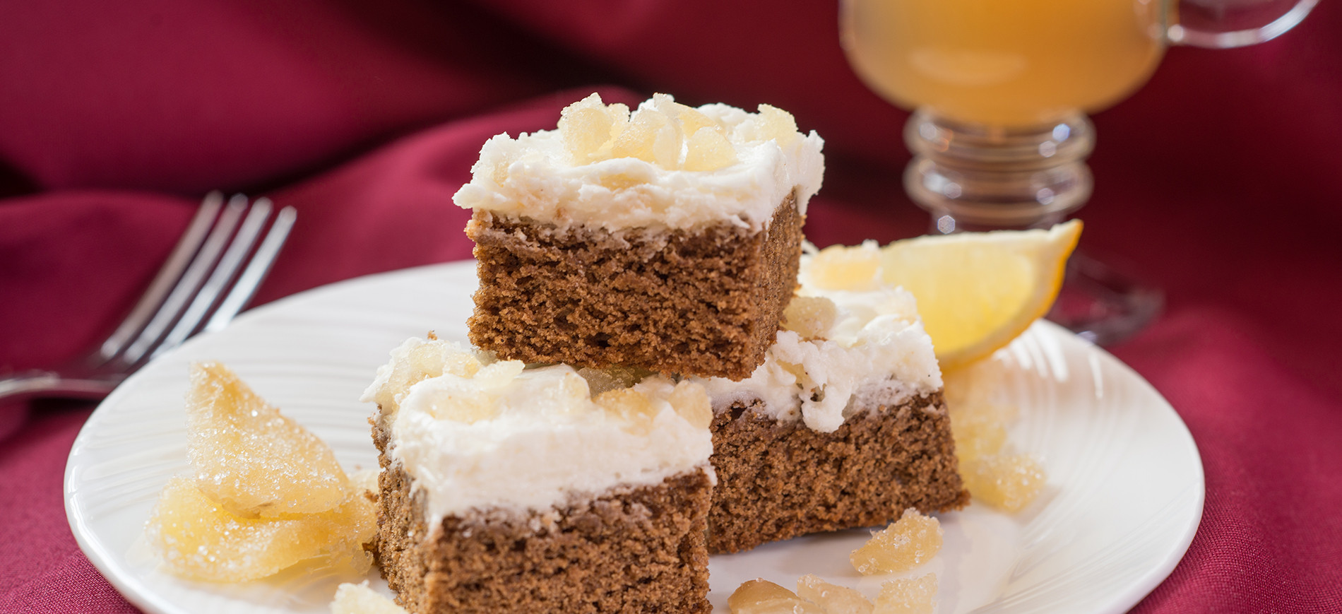 Gingerbread bars on white plate and red tablecloth