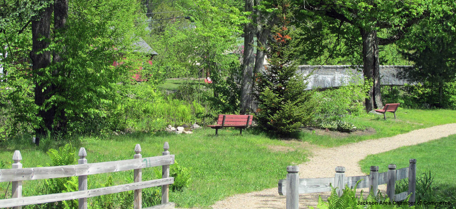 Jackson NH village path with bench facing river