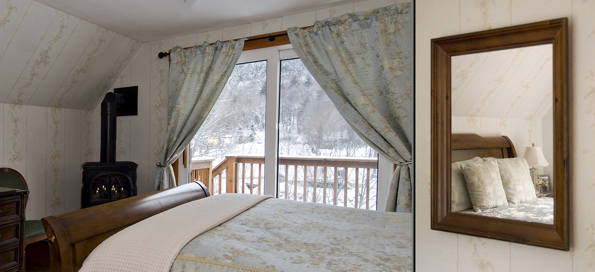 Guest room with chest & TV, chair, gas woodstove, sliding glass doors onto snowy balcony, queen bed with silver blue bedding reflected in mirror