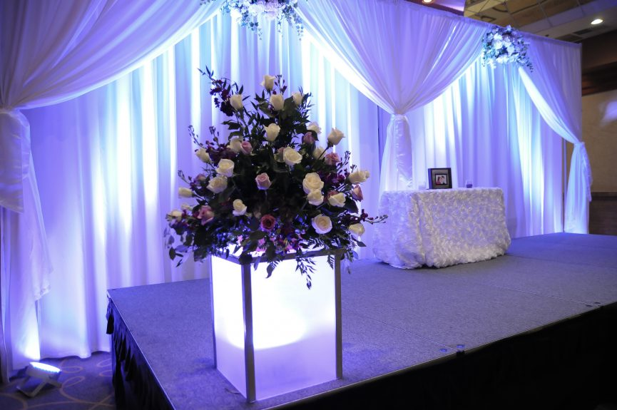 Purple and white flowers on stage