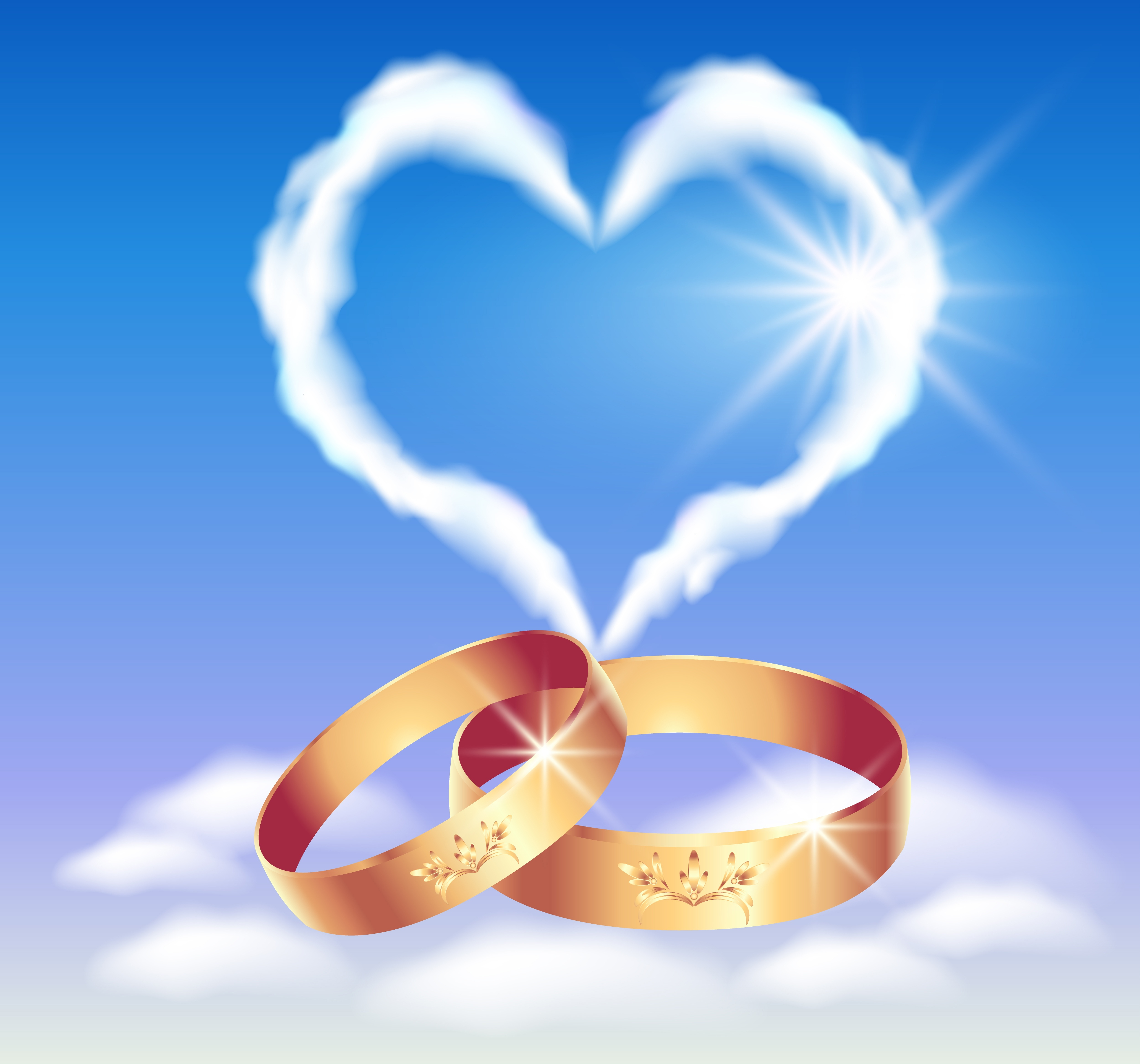 12168715 - card with wedding rings and heart in the clouds