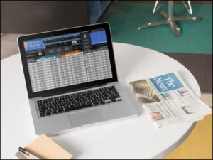 Image of the TJS Trading Log on a laptop with a tabletop setting