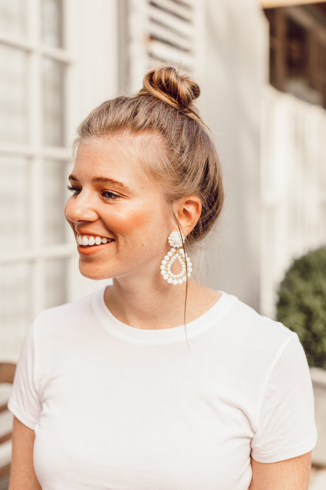 Step Out of Your Color Comfort Zone | Messy Topknot, Basic White Tee, White Statement Earrings styled on Louella Reese