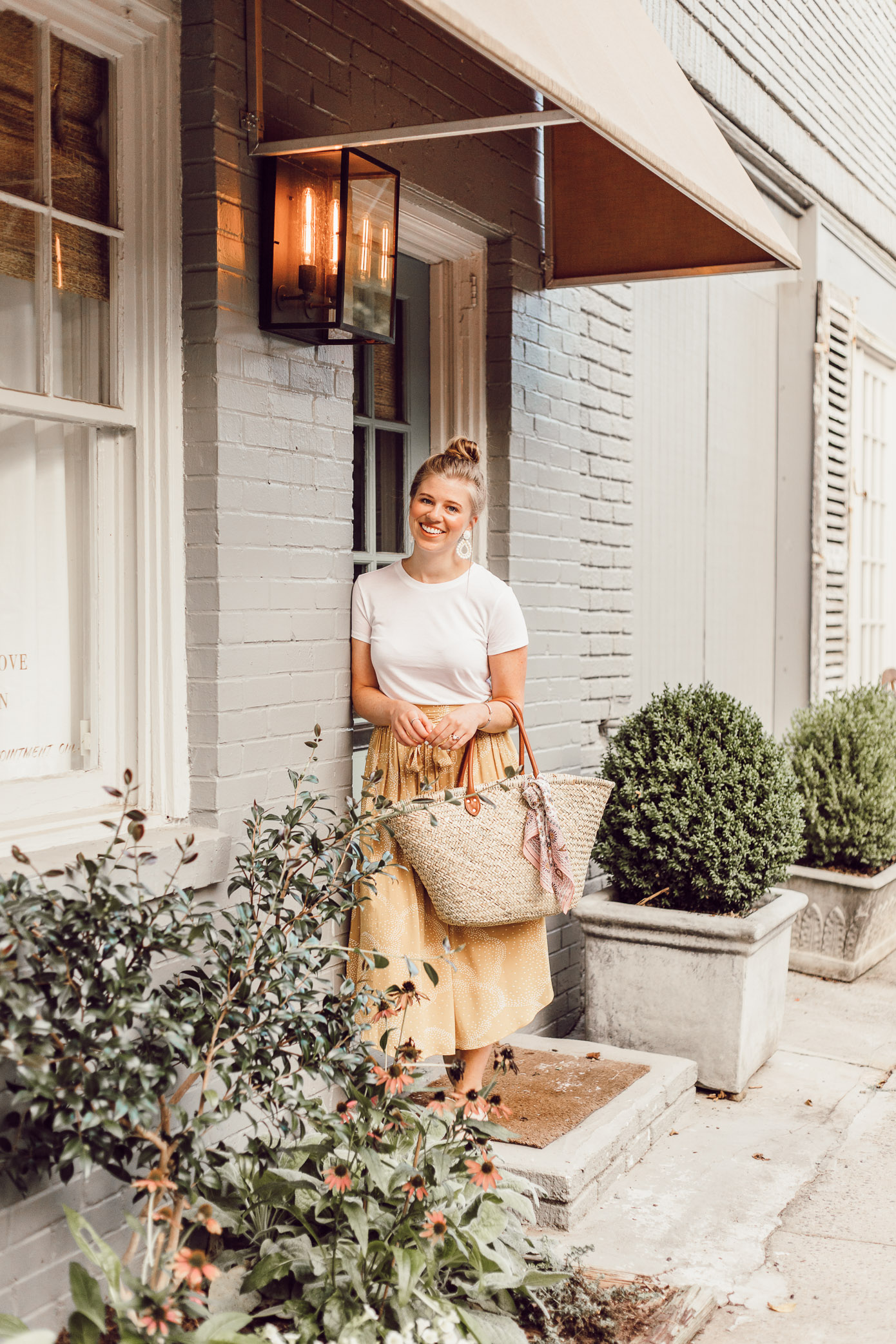 Step Out of Your Color Comfort Zone   Basic White Tee, Yellow Midi Skirt, Straw Tote styled on Louella Reese