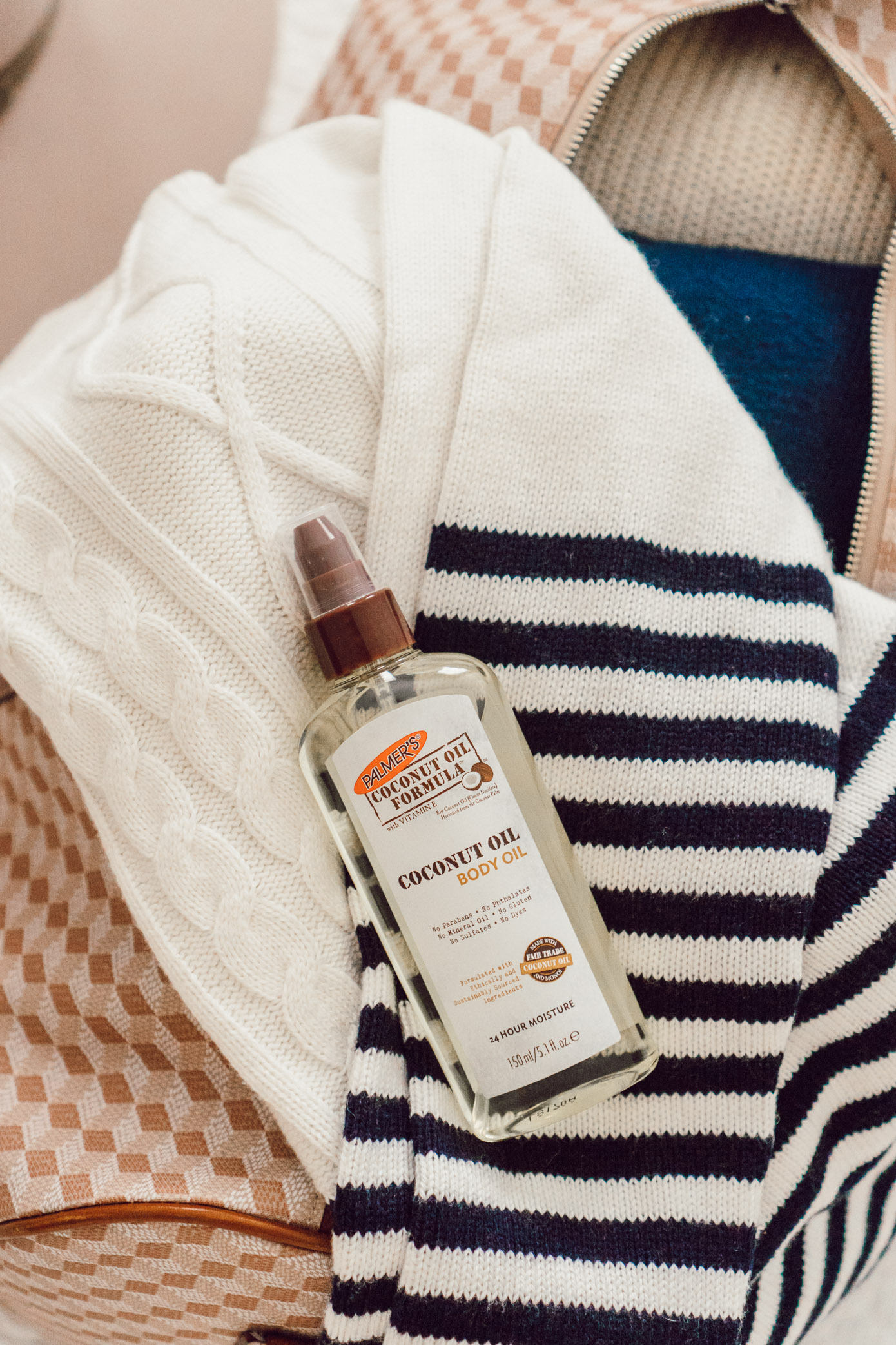 Body Oil, Coconut Oil Skincare | Five Ways to Hydrate Your Skin While Traveling featured on Louella Reese