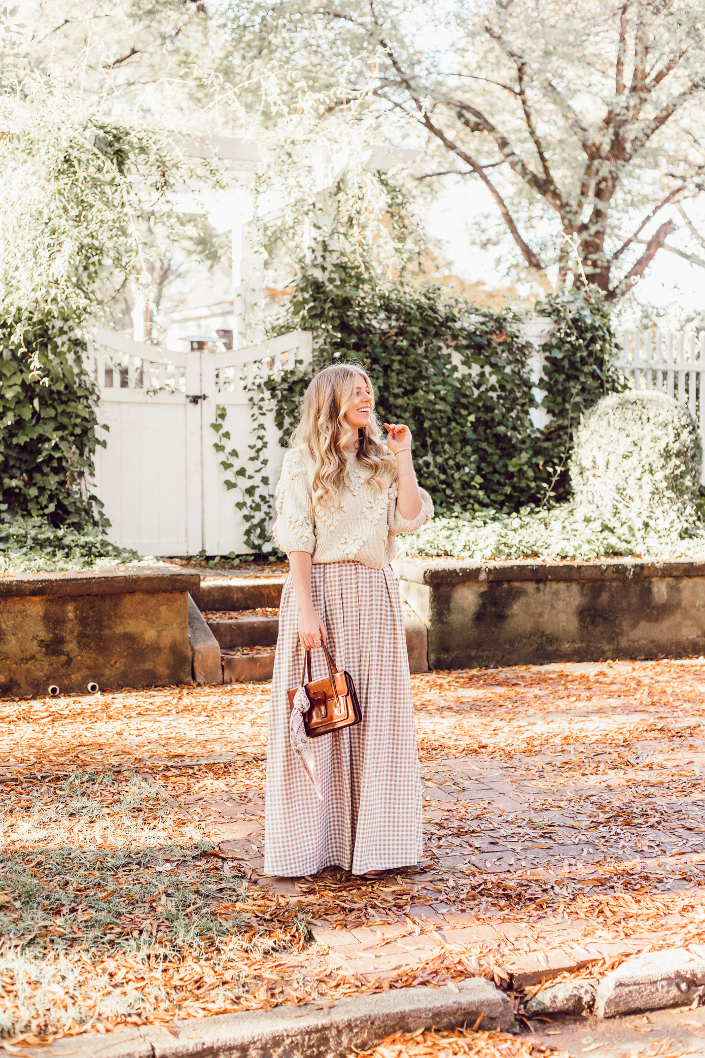 Spice Up Your Winter Date Night Look with a Winter Maxi Skirt featured on Louella Reese | Gingham Maxi Skirt, Pommed Heart Sweater