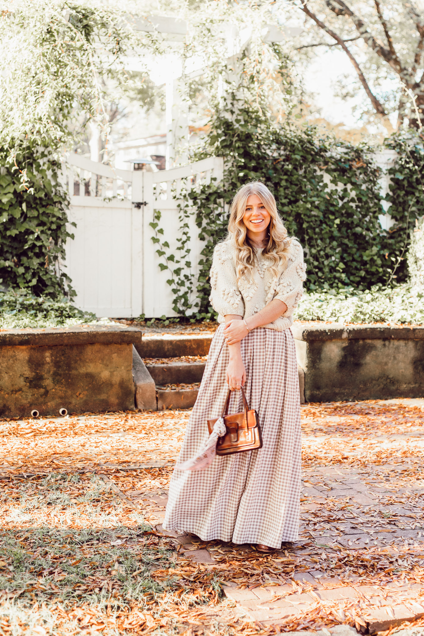 Spice Up Your Winter Date Night Look with a Winter Maxi Skirt featured on Louella Reese Life & Style Blog | Gingham Maxi Skirt, Pommed Heart Sweater