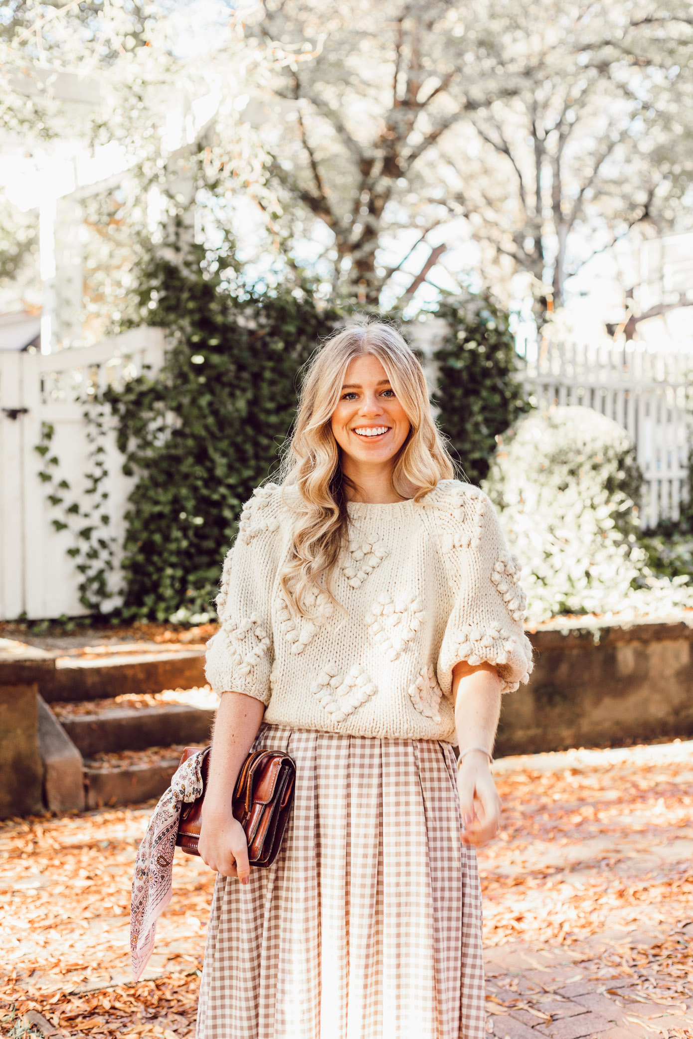 Spice Up Your Winter Date Night Look with a Winter Maxi Skirt featured on Louella Reese Blog | Gingham Maxi Skirt, Pommed Heart Sweater