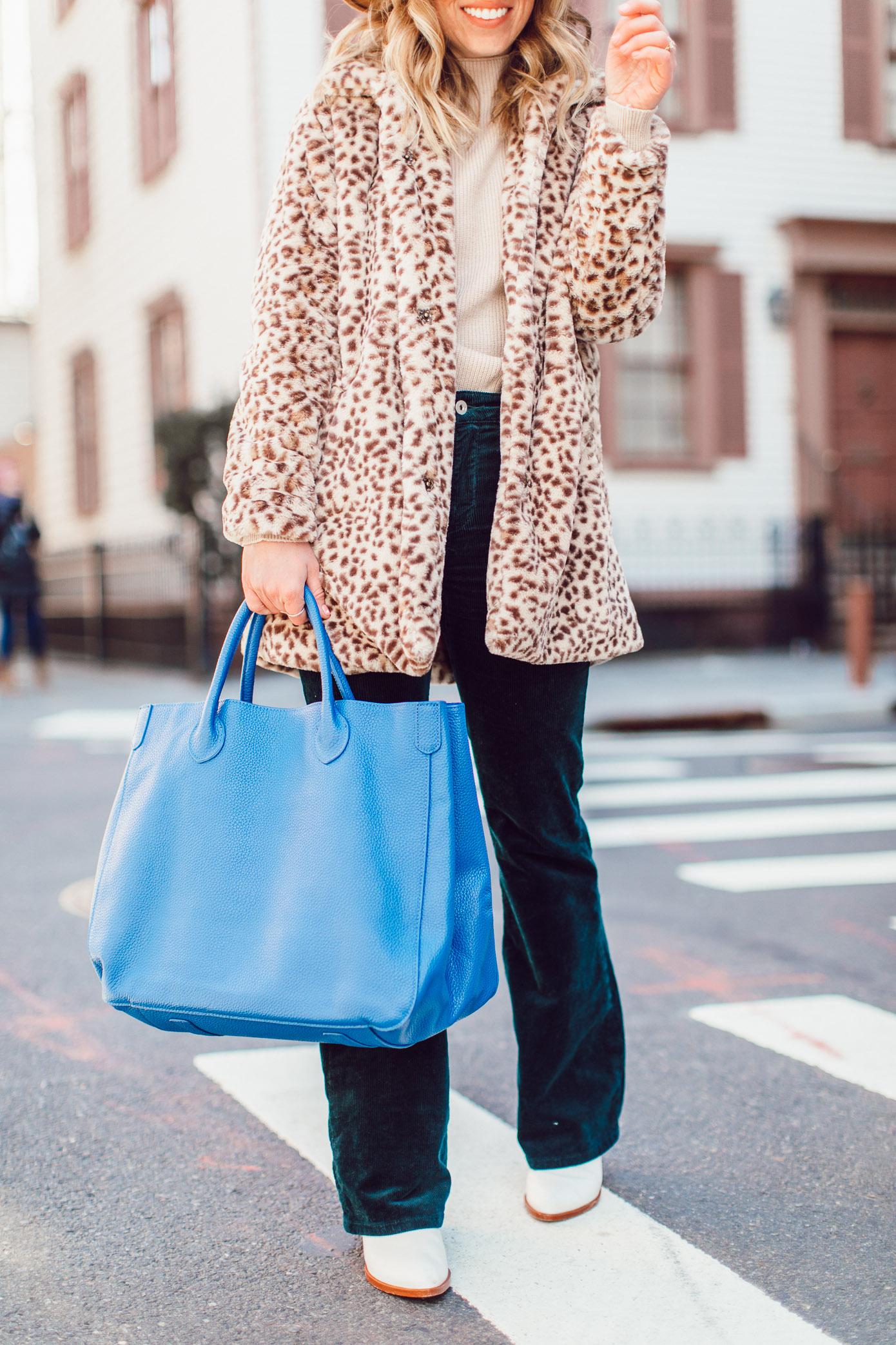 Winter Wardrobe Basics | Retro Outfit Idea - Faux Fur Leopard Coat, Corduroy Pants, Bright Blue Leather Tote, Bronze Felt Hat, White Booties featured on Louella Reese