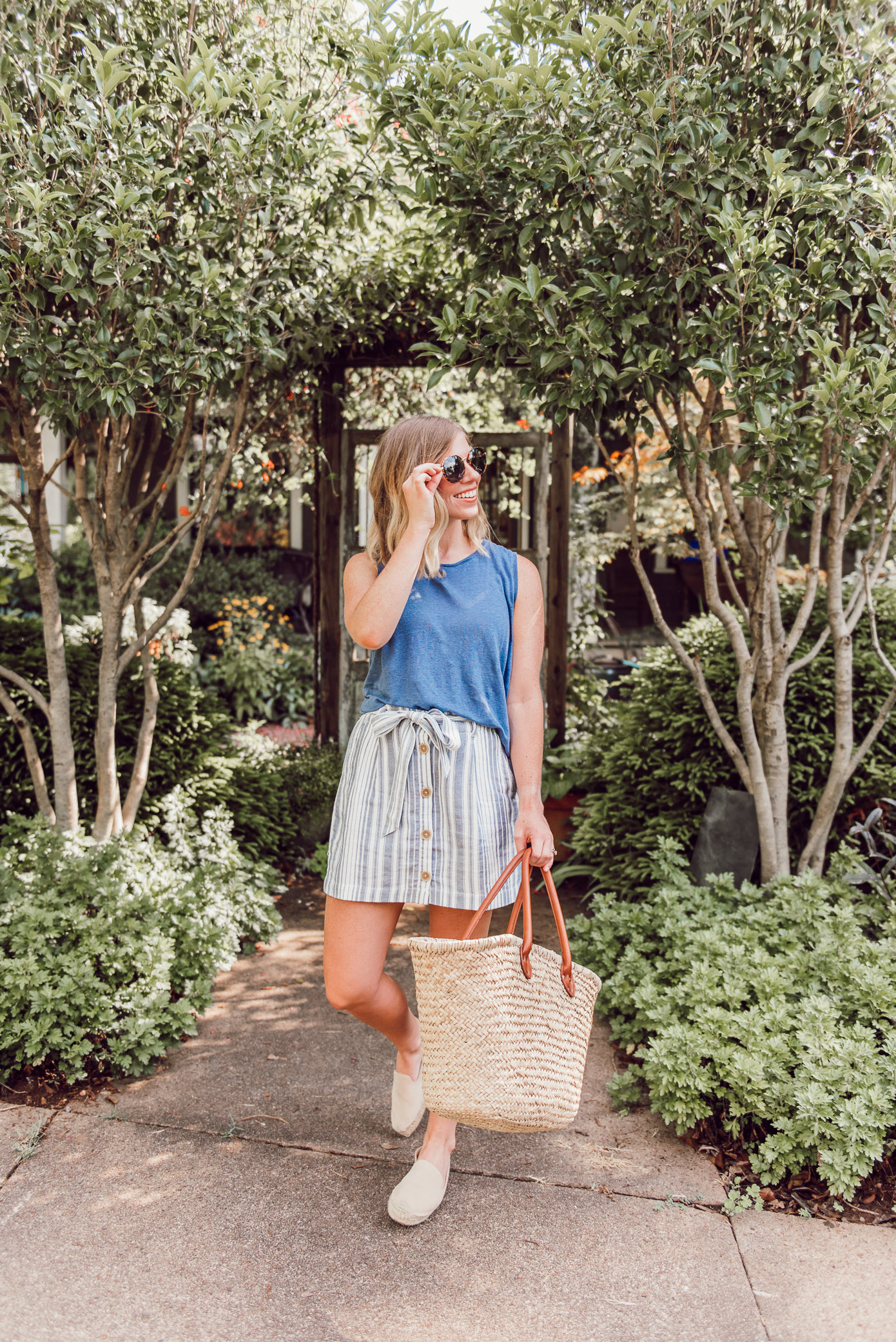 Summer linen clothing pieces that are lightweight and easy to throw on | linen tank, linen mini skirt, straw tote, neutral espadrilles | Louella Reese