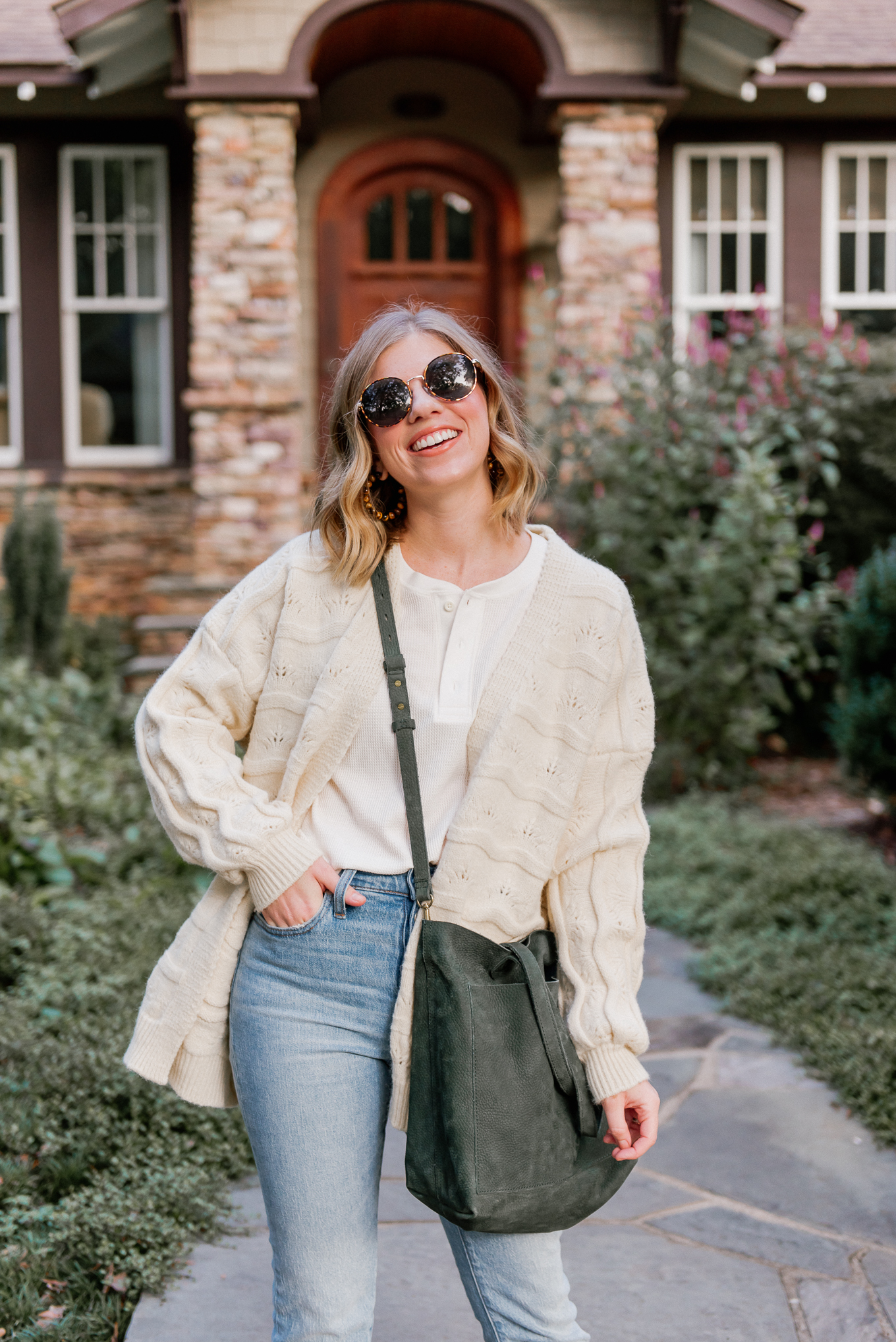 Six Cozy Fall Cardigans | Casual Fall Outfit featuring Ivory Knit Cardigan, Waffle Henley, Demi-Boot Crop Jeans, Olive Leather Tote | Louella Reese
