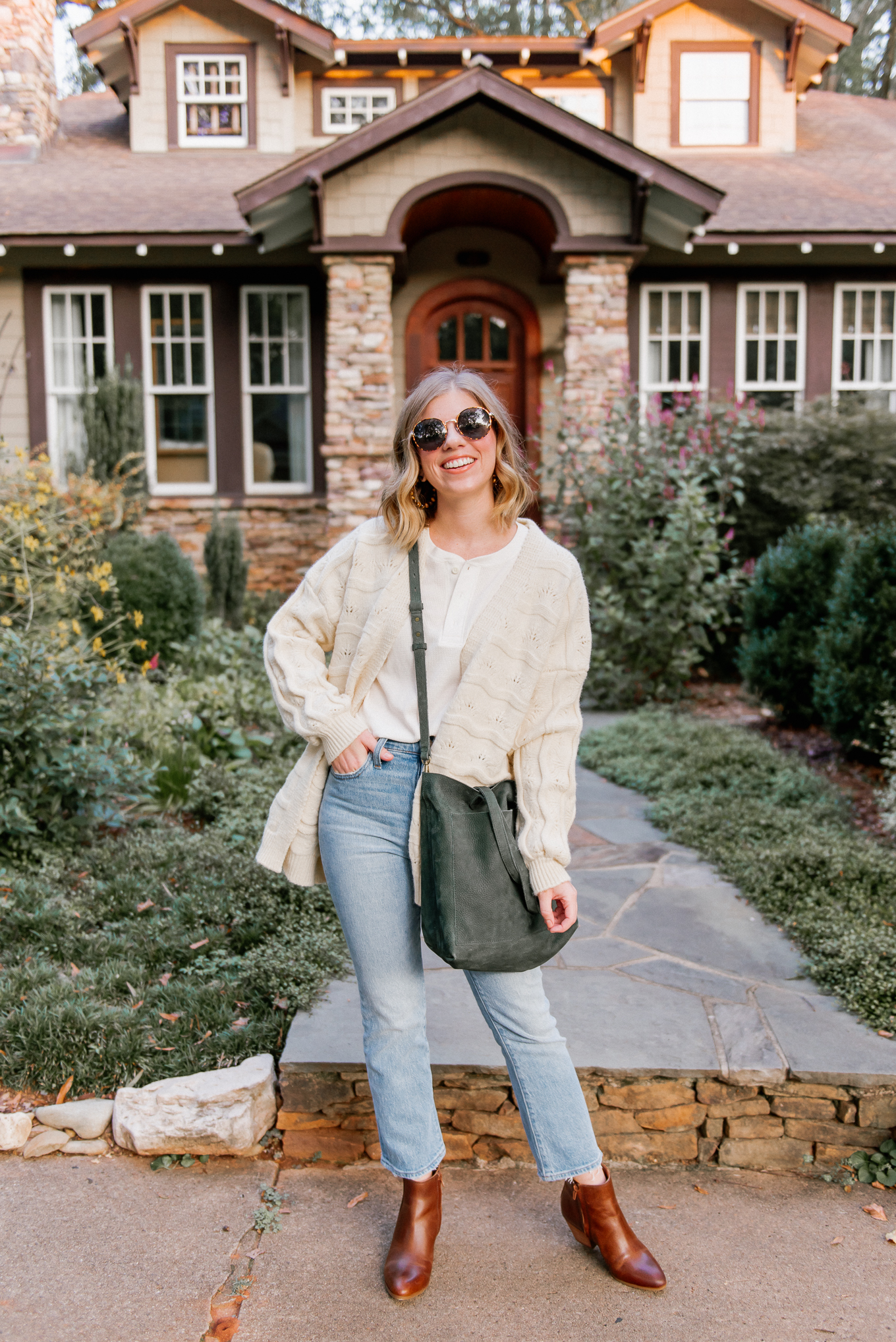 Six Cozy Fall Cardigans | Casual Fall Outfit featuring Ivory Knit Cardigan, Waffle Henley, Demi-Boot Crop Jeans, Cognac Leather Booties, Olive Leather Tote | Louella Reese