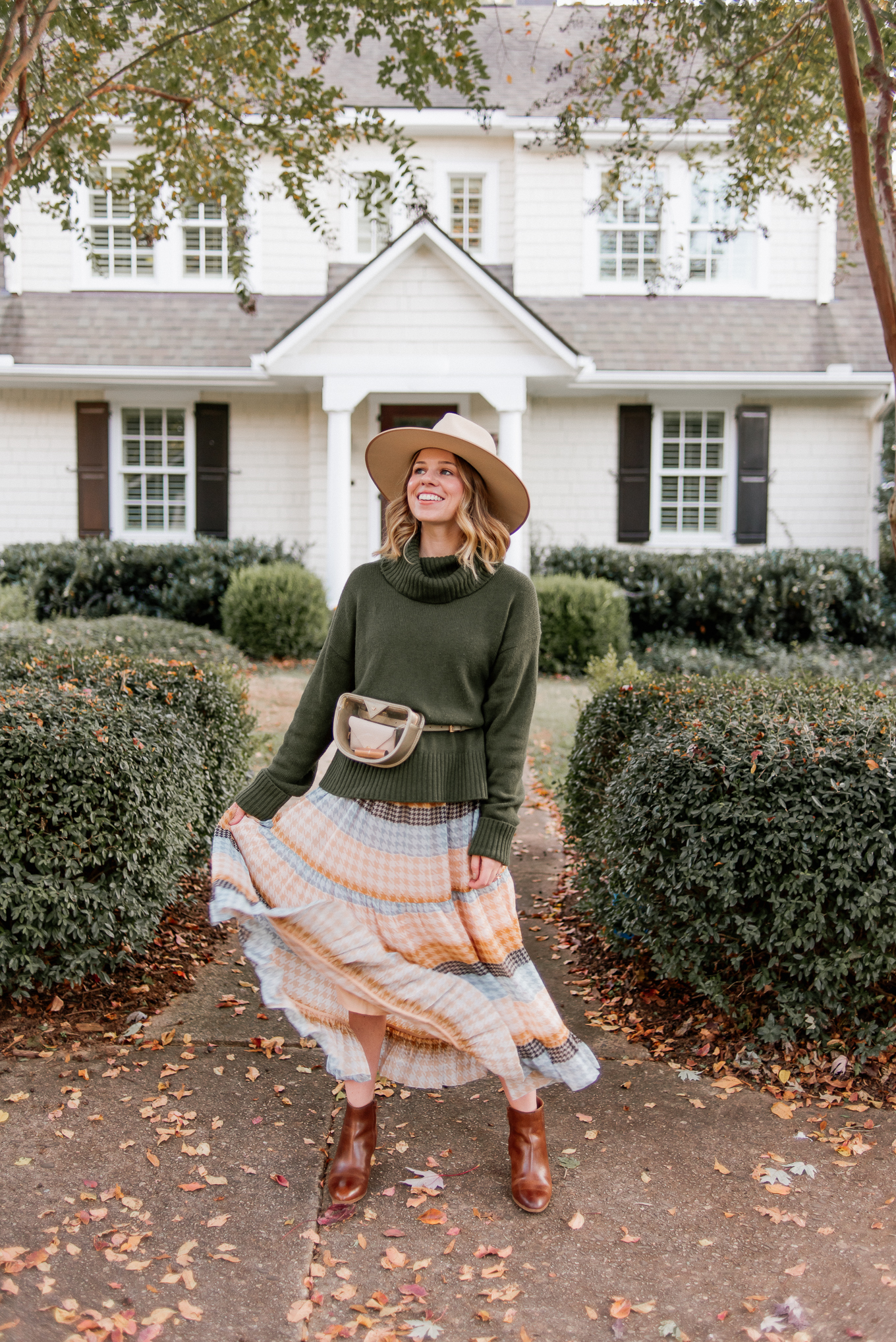 Clear Game Day Belt Bag | Turtleneck Sweater, Plaid Midi Dress, Cognac Leather Booties, Lack of Color Wool Hat, Metallic Clear Belt Bag | Louella Reese