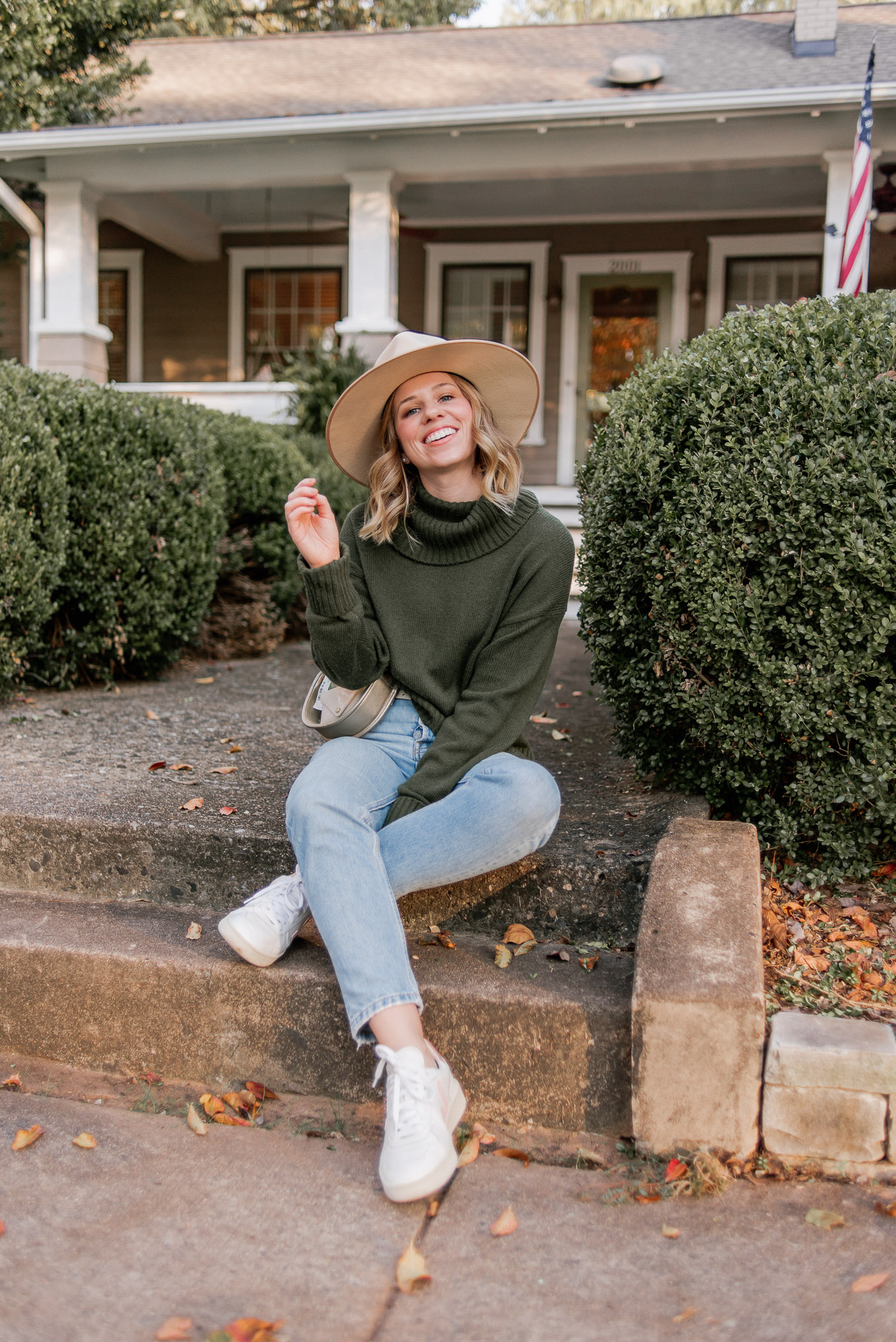 How to Create Mini Capsule Wardrobes | Casual Game Day Outfit Idea | Turtleneck Sweater, Demi-Boot Jeans, Veja Sneakers, Lack of Color Wool Hat | Louella Reese
