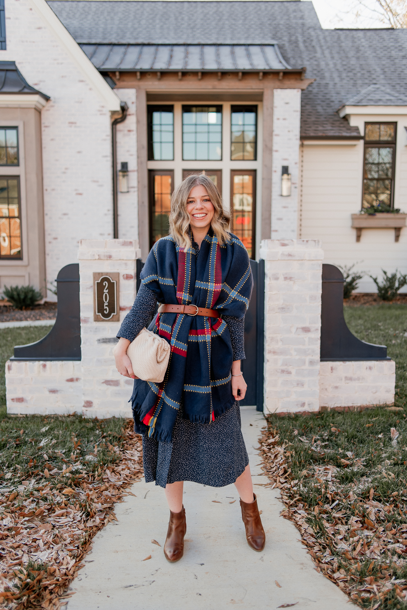 Laura Leigh of Louella Reese shares how to style a scarf as vest this winter season | navy check scarf, navy shirt dress, cognac leather chelsea boots