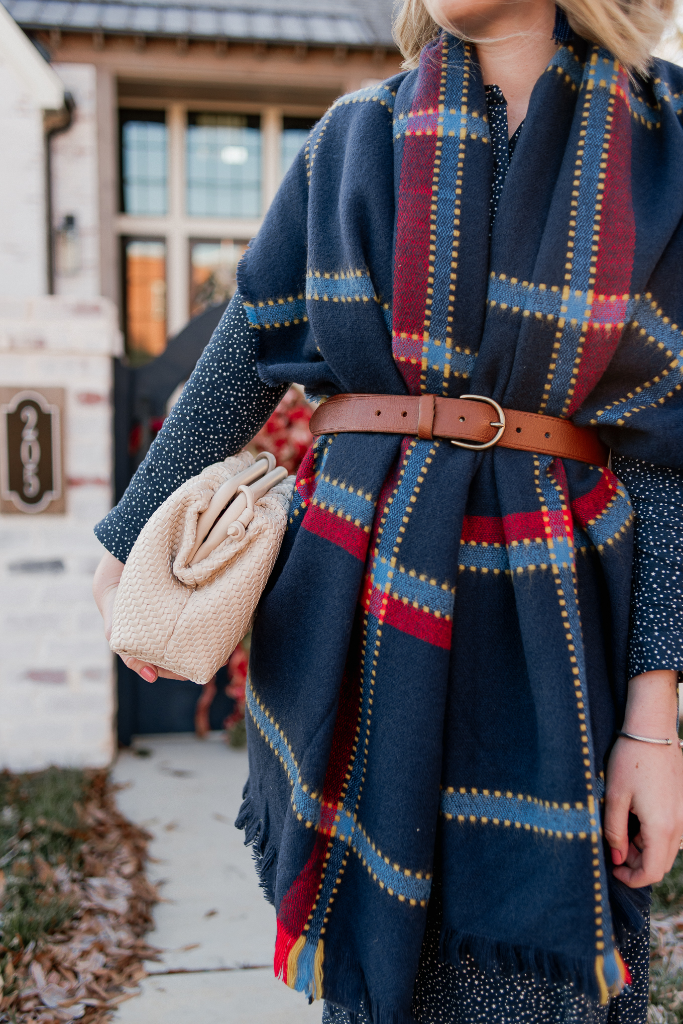 Laura Leigh of Louella Reese shares how to style a scarf as a vest this winter season plus a great BOTTEGA VENETA pouch dupe