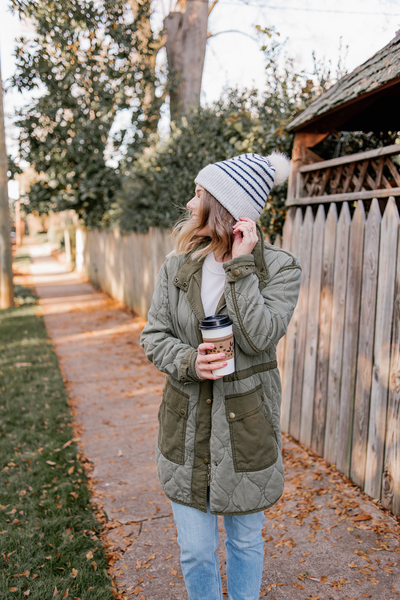 Laura Leigh Elliott of Louella Reese layers a cozy cashmere sweater from Everlane with a quilted field jacket and beanie