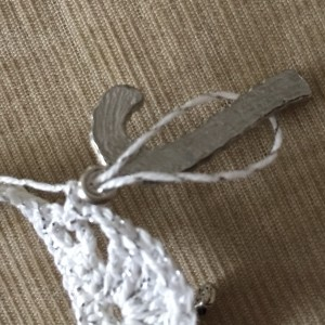 How to add charms to a crochet necklace