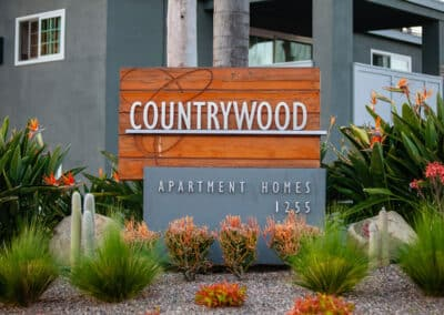 Countrywood Apartment Homes Entrance Sign with plants